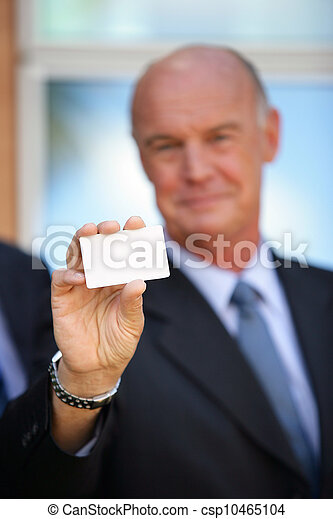 Businessman holding up his business card - csp10465104