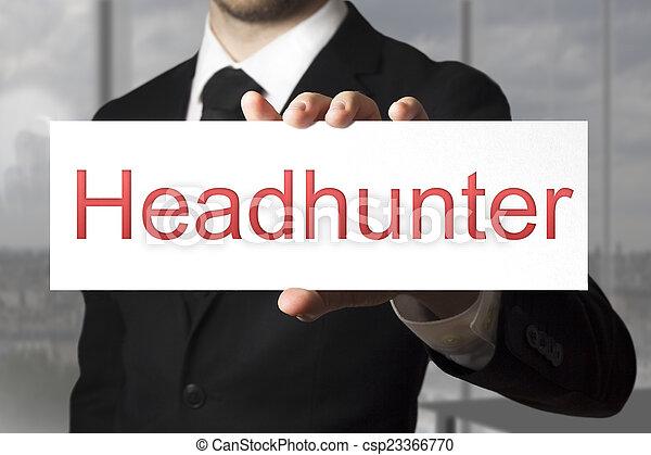 businessman holding white sign headhunter - csp23366770