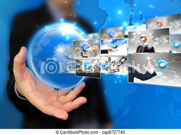 Businessman holding world .Technology concept  - csp9727740