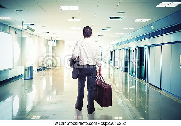 Businessman in airport ready to travel - csp26616252