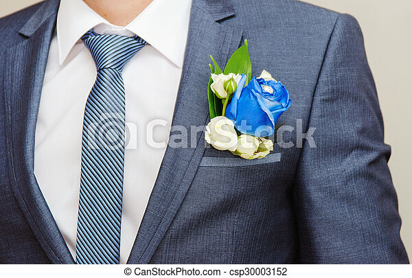 Businessman in blue suit tying the necktie - csp30003152