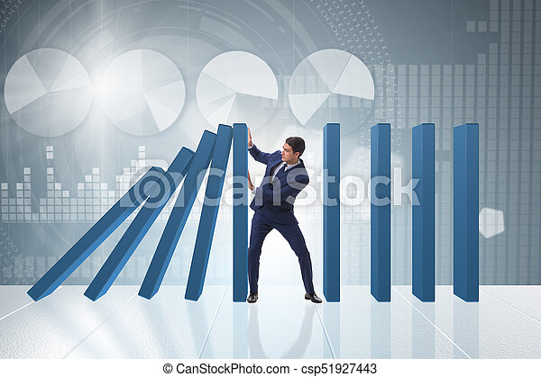 Businessman in domino effect business concept - csp51927443