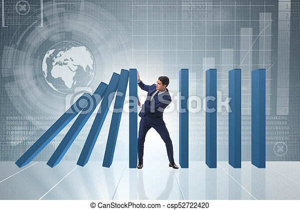 Businessman in domino effect business concept - csp52722420