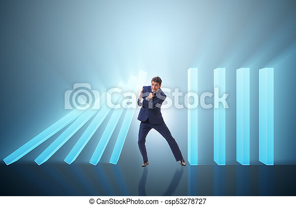 Businessman in domino effect business concept - csp53278727