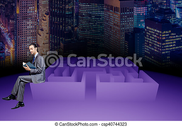 Businessman in maze business concept - csp40744323