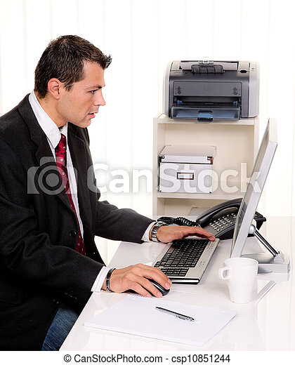 businessman in office with computer - csp10851244