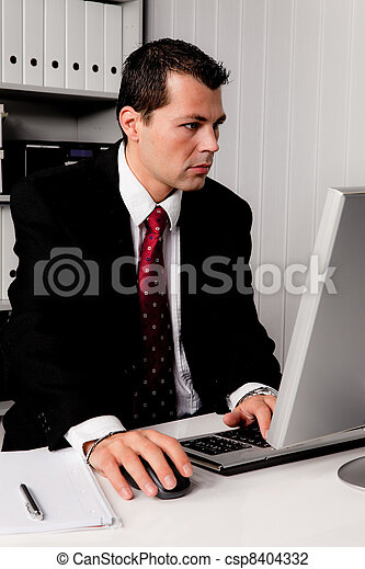 businessman in office with computer - csp8404332