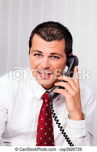 Businessman in office with telephone - csp3926726