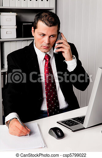 Businessman in office with telephone - csp5799022