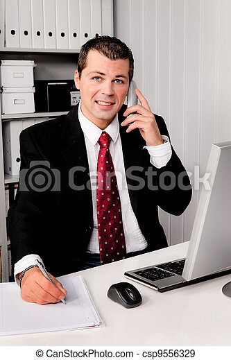businessman in office with telephone - csp9556329