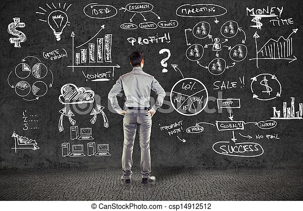 businessman in suit and business plan on grunge wall - csp14912512