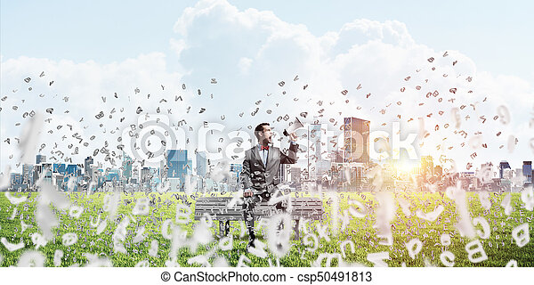 Businessman in summer park on bench announcing something in loudspeaker and symbols fly around - csp50491813