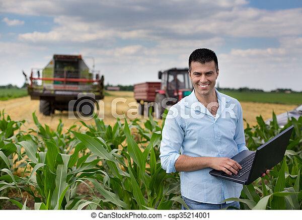 Businessman in the field - csp35214001