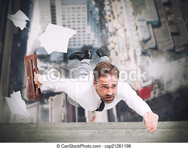 Businessman is going to fall - csp21261196
