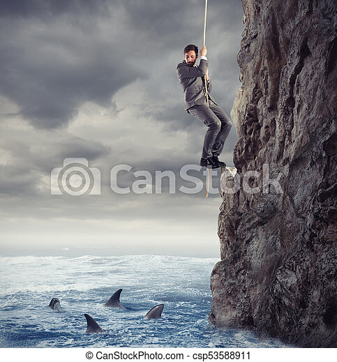 Businessman is likely to fall into the sea with sharks. concept of problems and difficulty in business - csp53588911