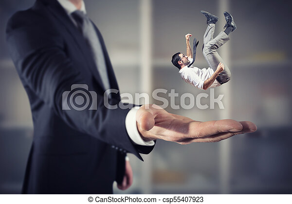 Businessman is saved from a big hand. Concept of business support and assistance - csp55407923