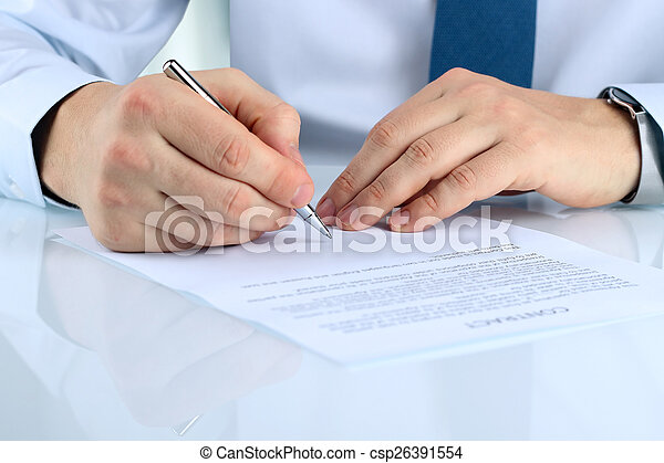 Businessman is signing a contract, business contract details - csp26391554