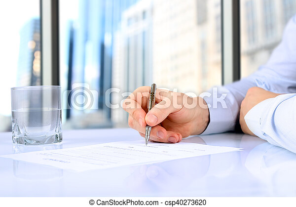 Businessman is signing a contract, business contract details - csp40273620