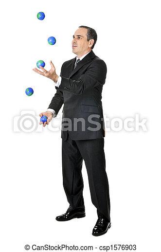 Businessman juggling - csp1576903