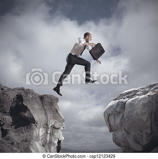 Businessman jumping over the mountains - csp12123429