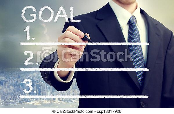 Businessman Listing Goals - csp13017928