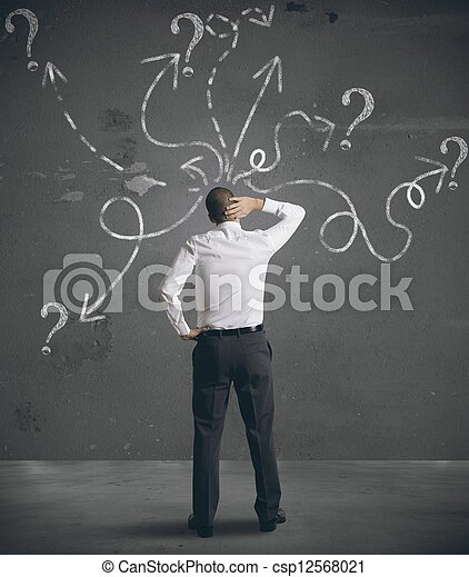 Businessman looking at arrows pointed in different directions - csp12568021