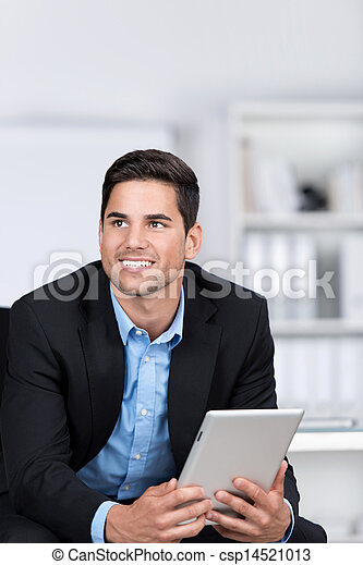 Businessman Looking Away While Holding Digital Tablet - csp14521013