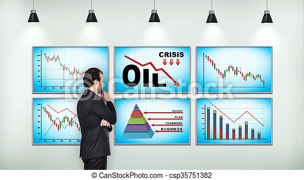 Businessman looking on chart of falling oil prices - csp35751382