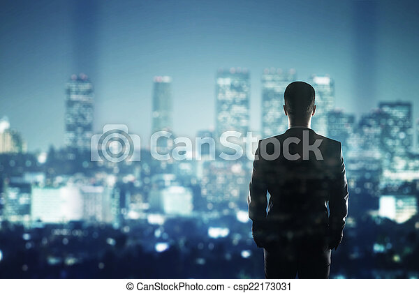 businessman looking to city - csp22173031