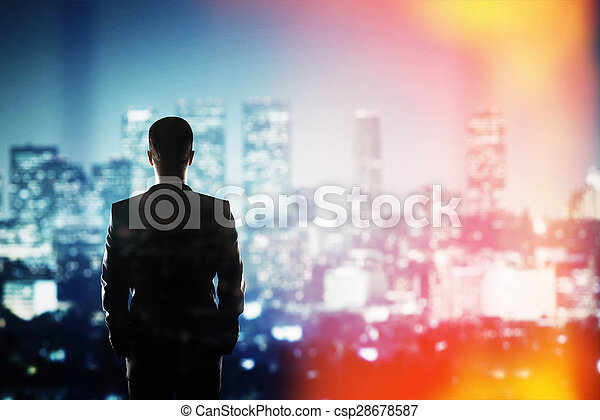 businessman looking to night city - csp28678587
