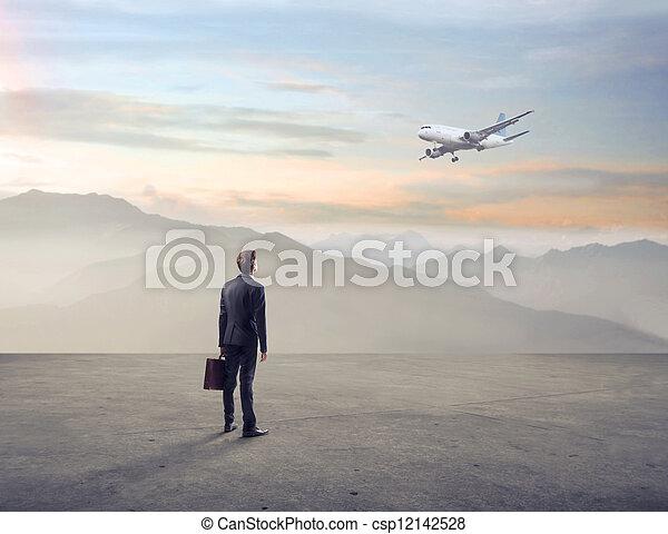 businessman looks airplane - csp12142528