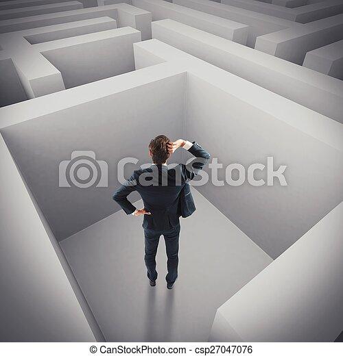 Businessman lost in a maze - csp27047076