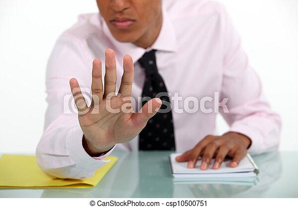 Businessman making a stop gesture - csp10500751