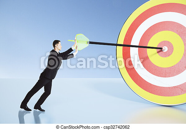Businessman making efforts to achieve the goal concept - csp32742062