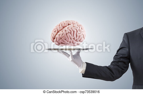 Businessman offering human brain on silver tray - csp73539016