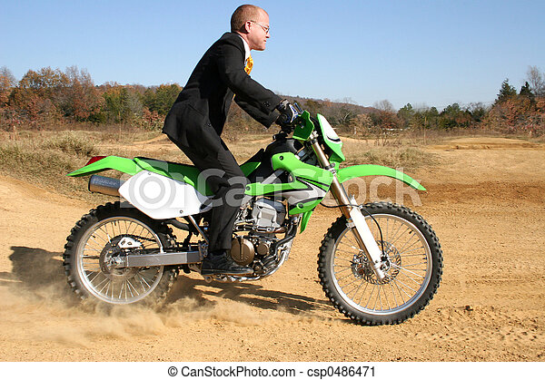 Businessman on Dirt Bike - csp0486471