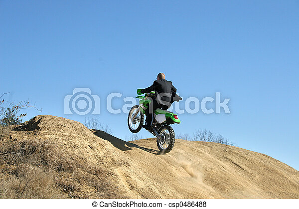 Businessman on Dirt Bike - csp0486488