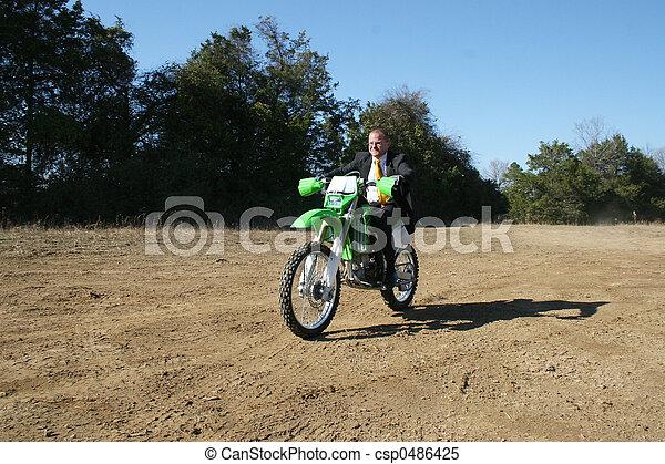Businessman on Dirt Bike - csp0486425
