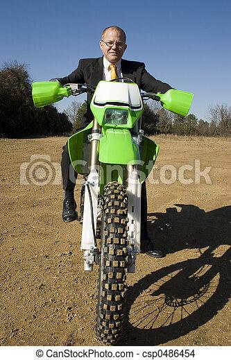 Businessman on Dirt Bike - csp0486454
