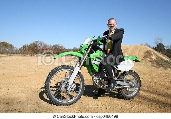 Businessman on Dirt Bike - csp0486499