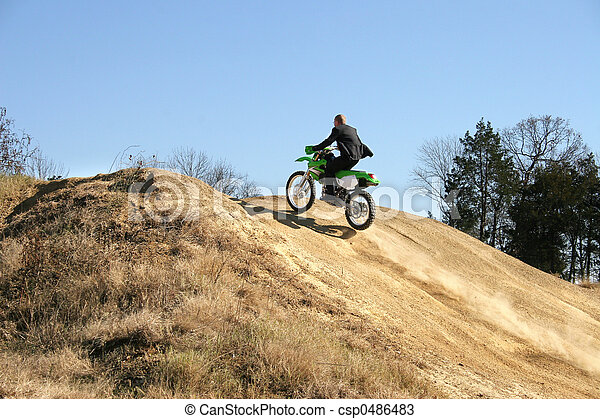 Businessman on Dirt Bike - csp0486483