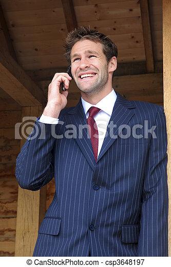 Businessman on his mobile phone - csp3648197