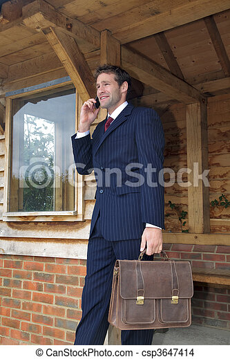 Businessman on his mobile phone - csp3647414