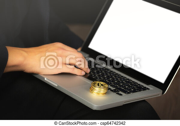 Businessman on laptop with bitcoin coins - csp64742342