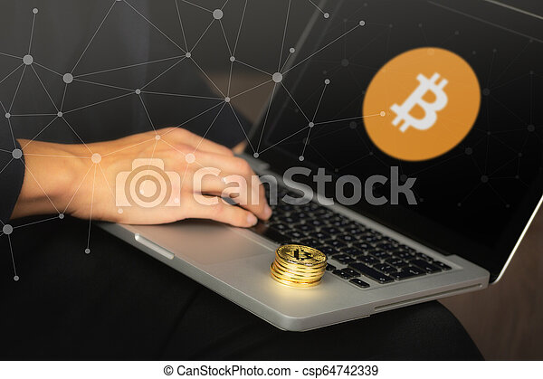 Businessman on laptop with bitcoin coins - csp64742339