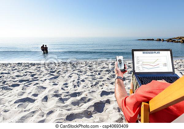 Businessman On the Beach - csp40693409