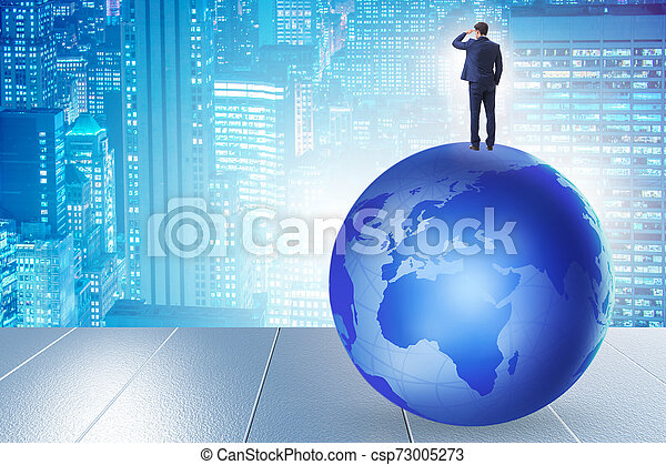 Businessman on top of the world - csp73005273