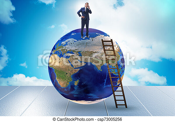 Businessman on top of the world - csp73005256