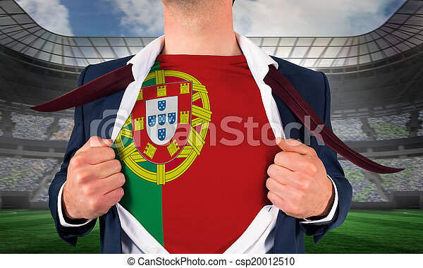 Businessman opening shirt to reveal portugal flag against large football stadium under spotlights - csp20012510