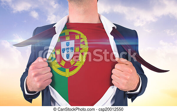 Businessman opening shirt to reveal portugal flag against beautiful orange and blue sky - csp20012550